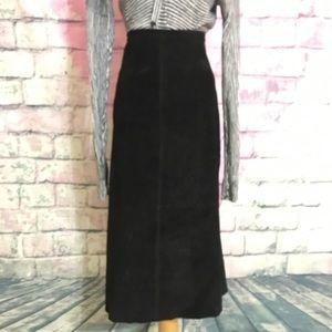 Midi length black suede skirt